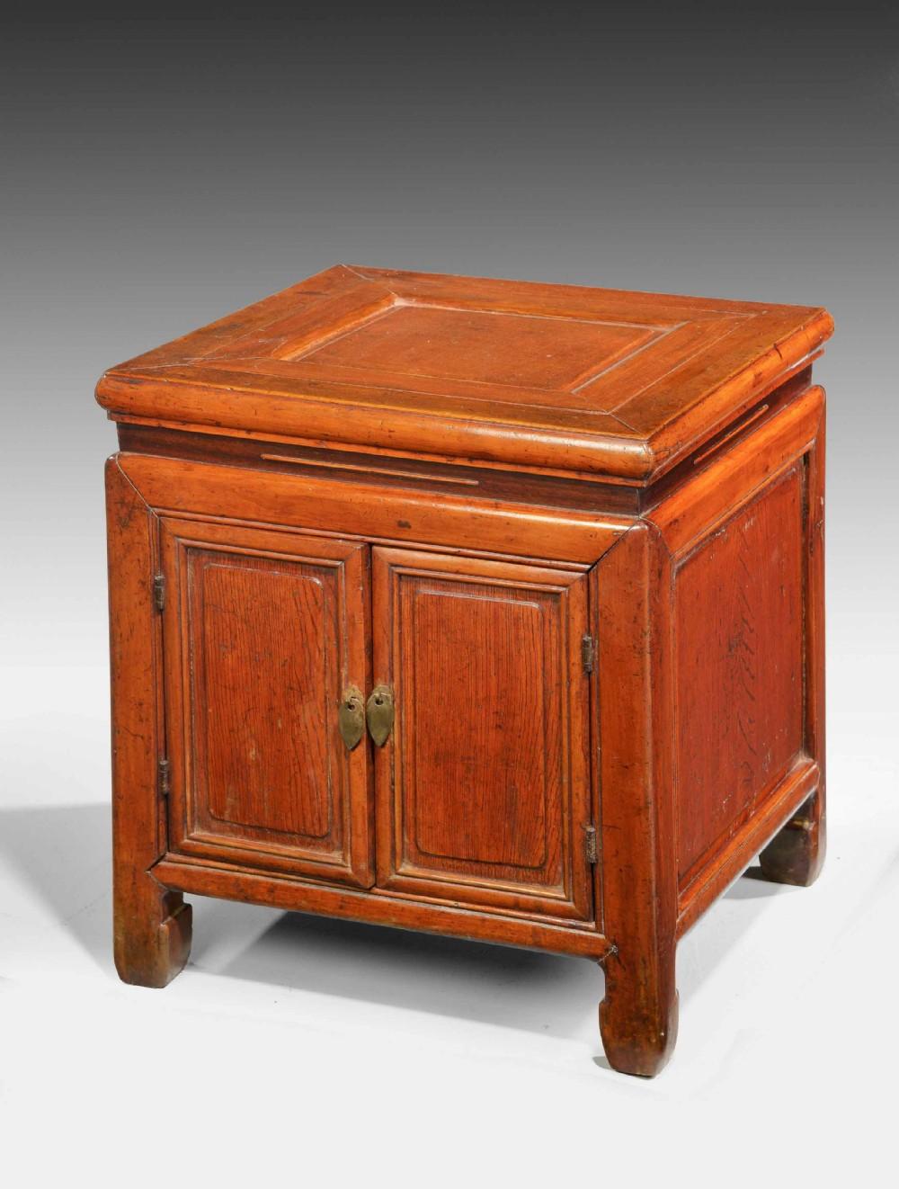 small 19th century oriental elm enclosed cabinet