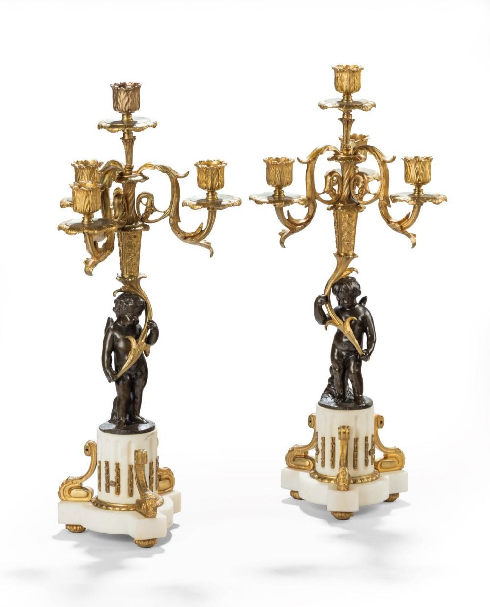 pair of bronze and gilt bronze candelabras