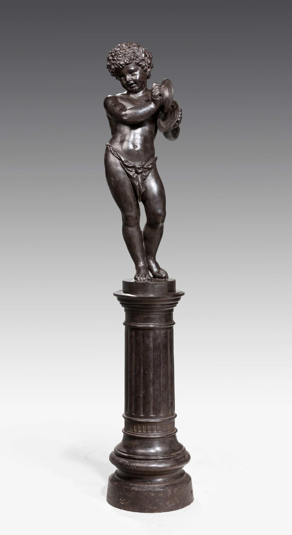 bronze patinated cast iron figure of a putti