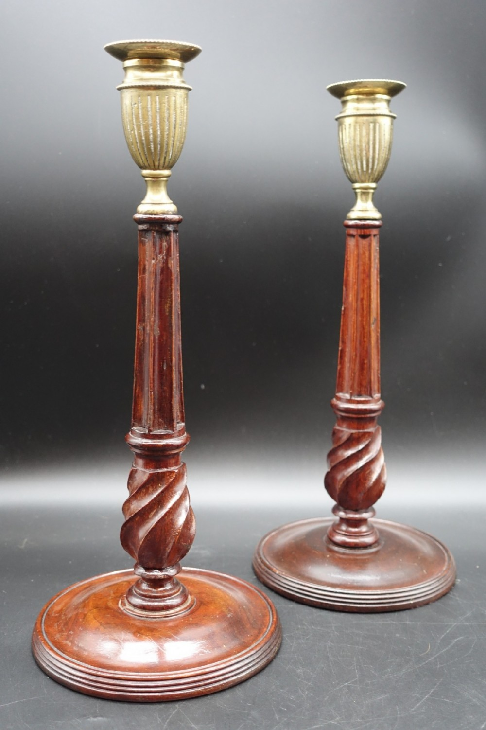 a fine pair of george iii period mahogany and brass candlesticks