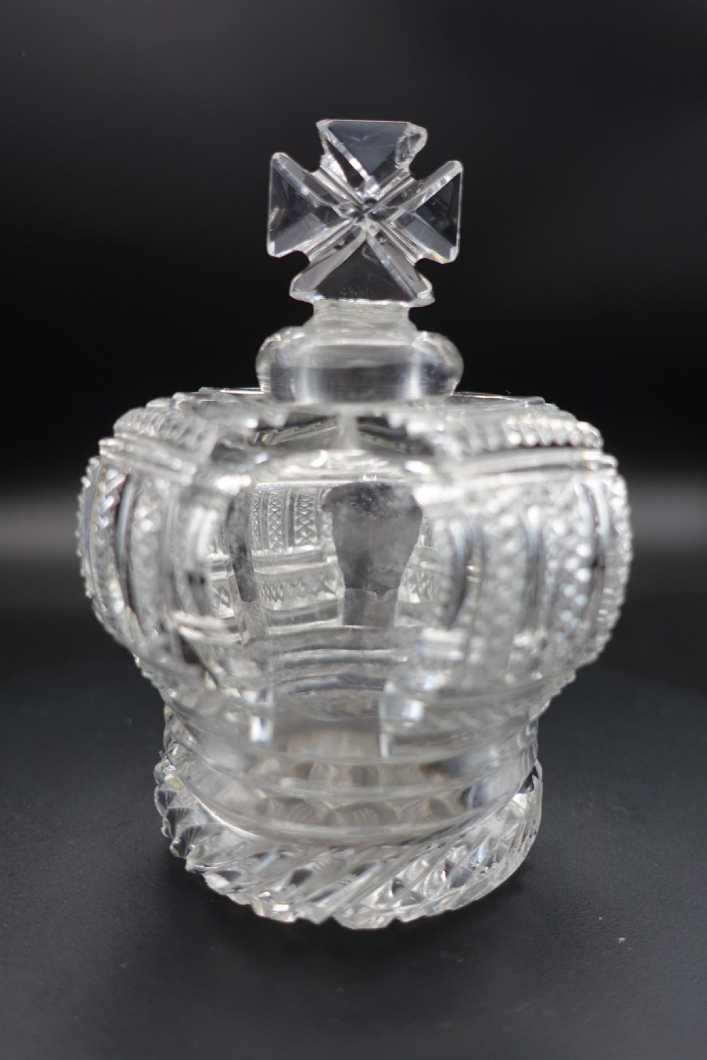 an early 20th century complex scent bottle in the shape of a crown