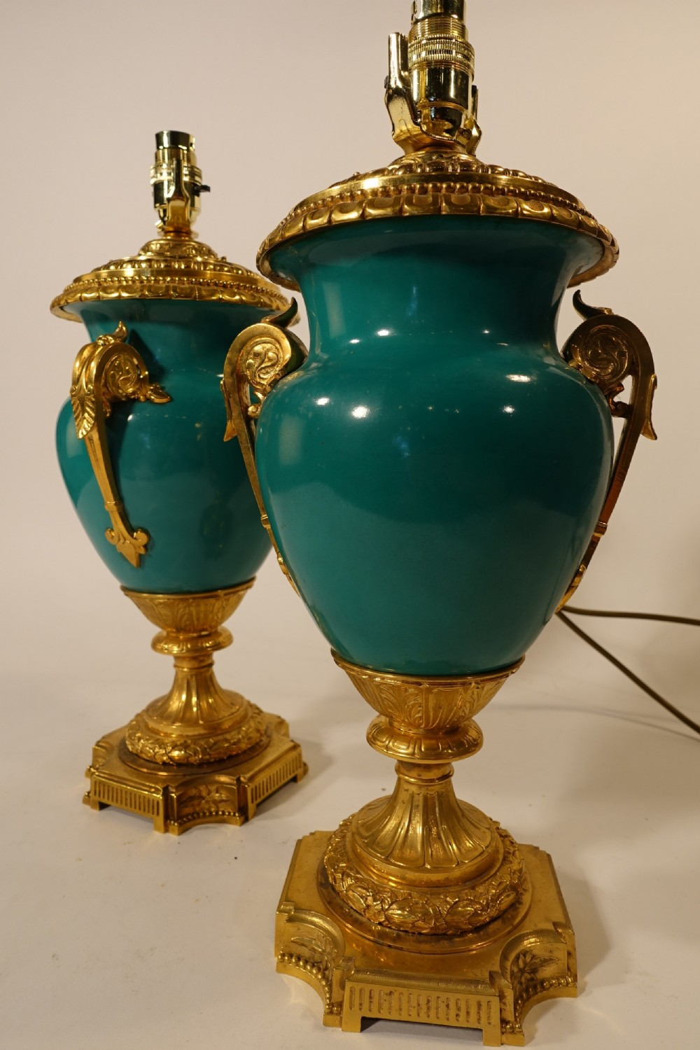 an exceptional pair of early 20th century french porcelain lamps