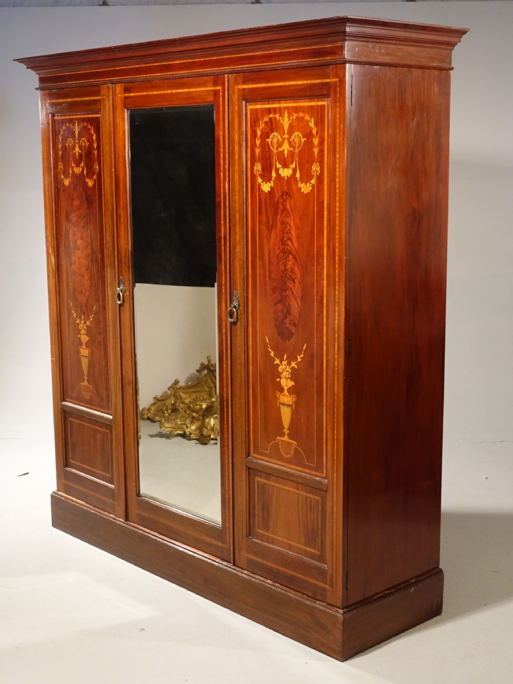 a very fine early victorian period inverted breakfront wardrobe