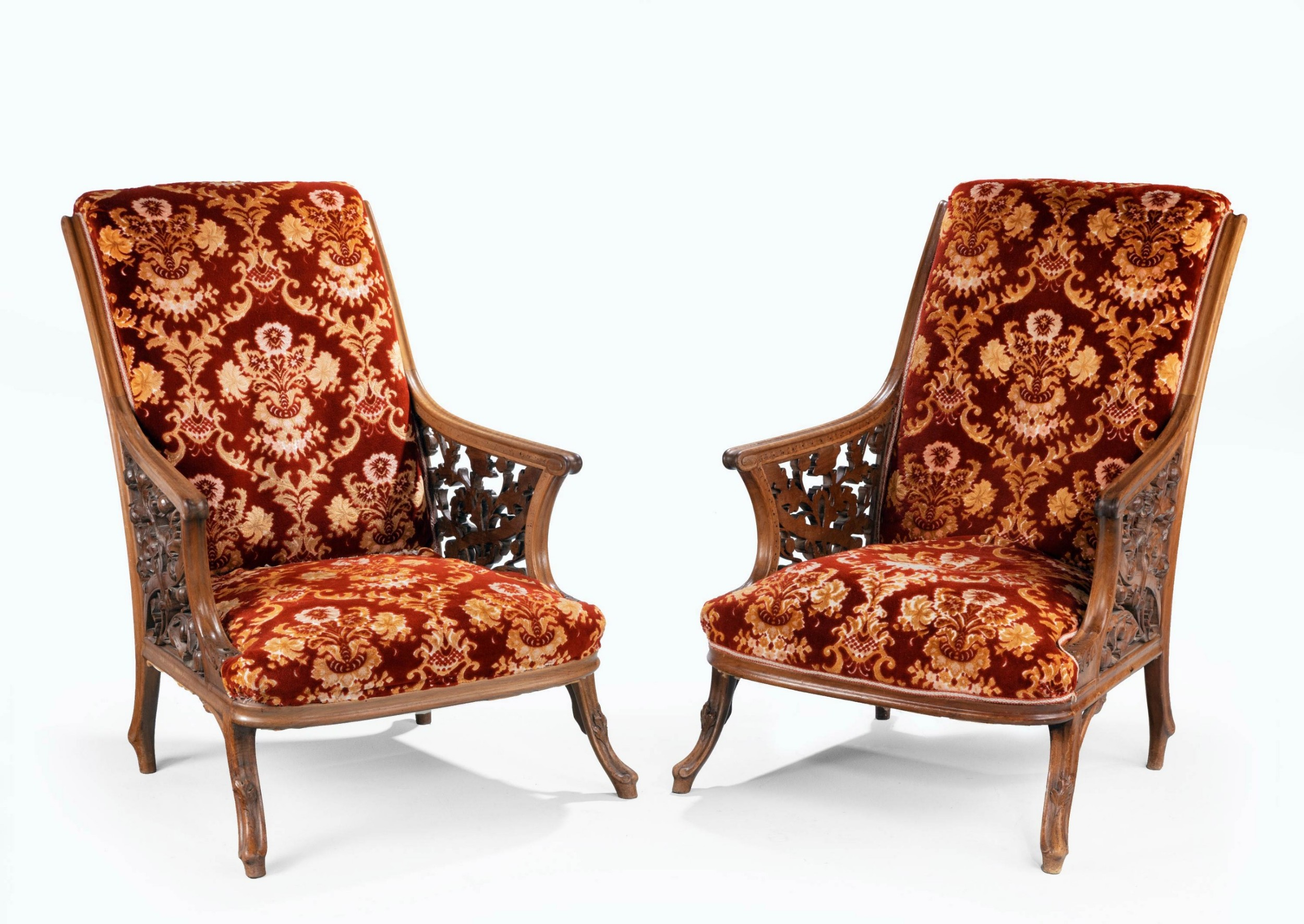 a most unusual and fine pair of 19th century mahogany framed easy chairs