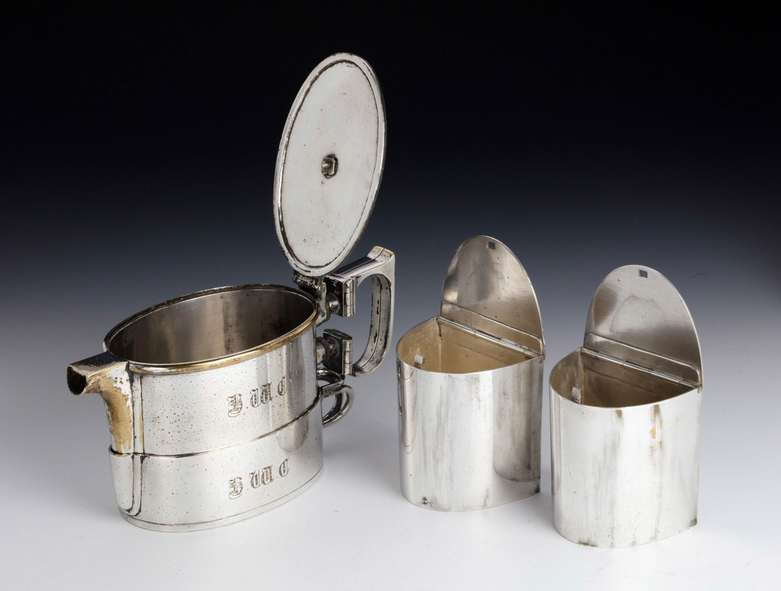 an early 20th century twin handled silver plated on nickel teapot
