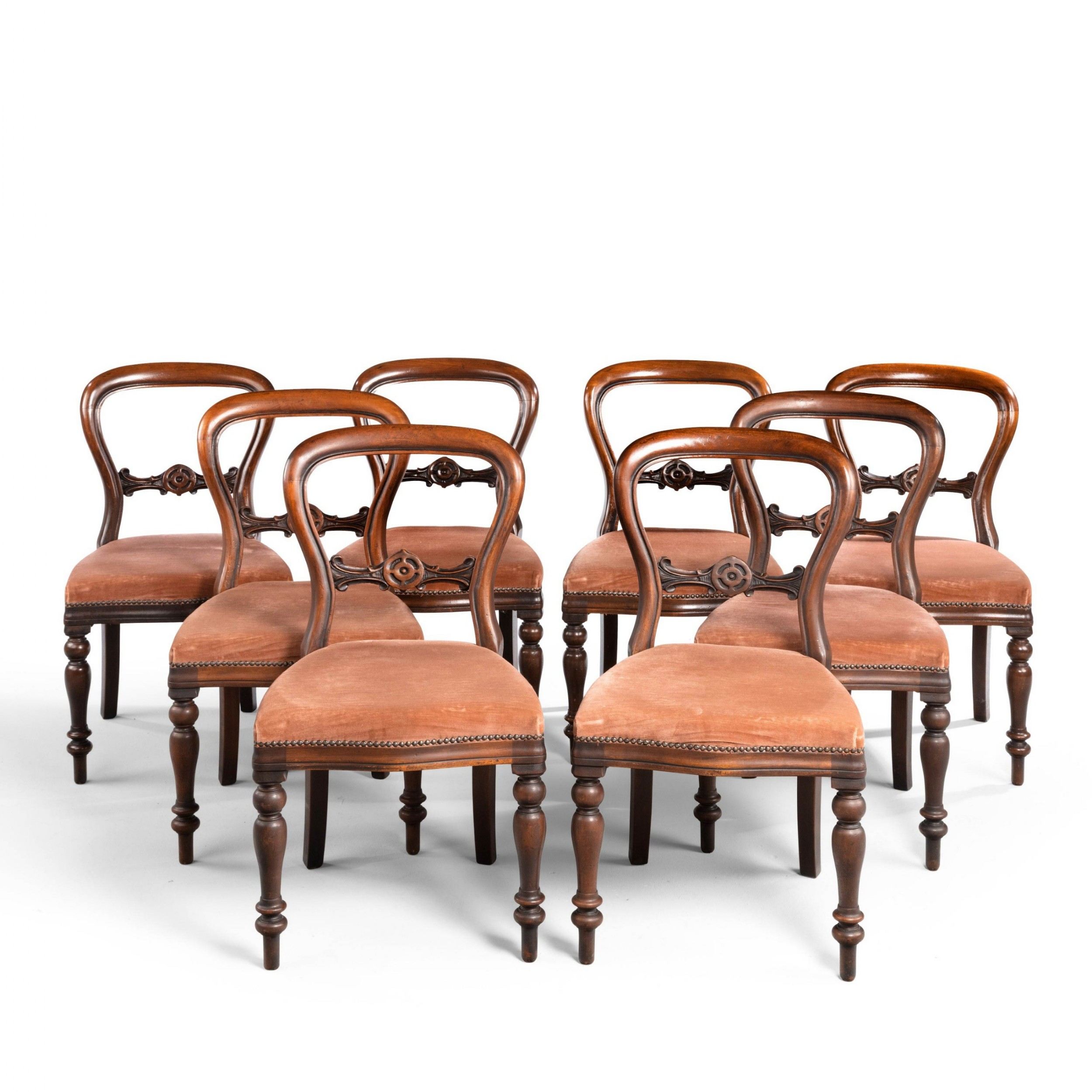 an attractive set of eight late 19th century balloon backed chairs