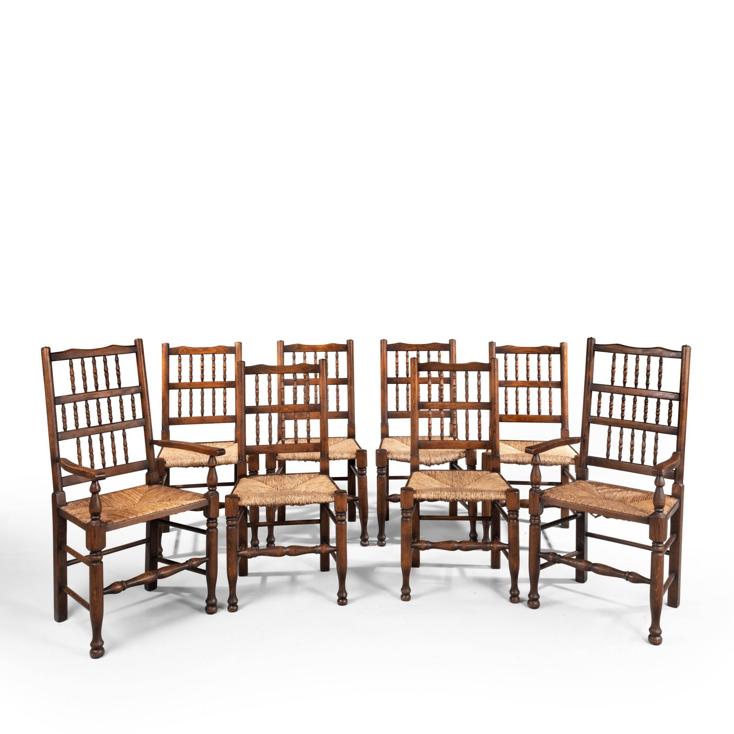 a very good set of 8 62 early 20th century stickbacked country chairs