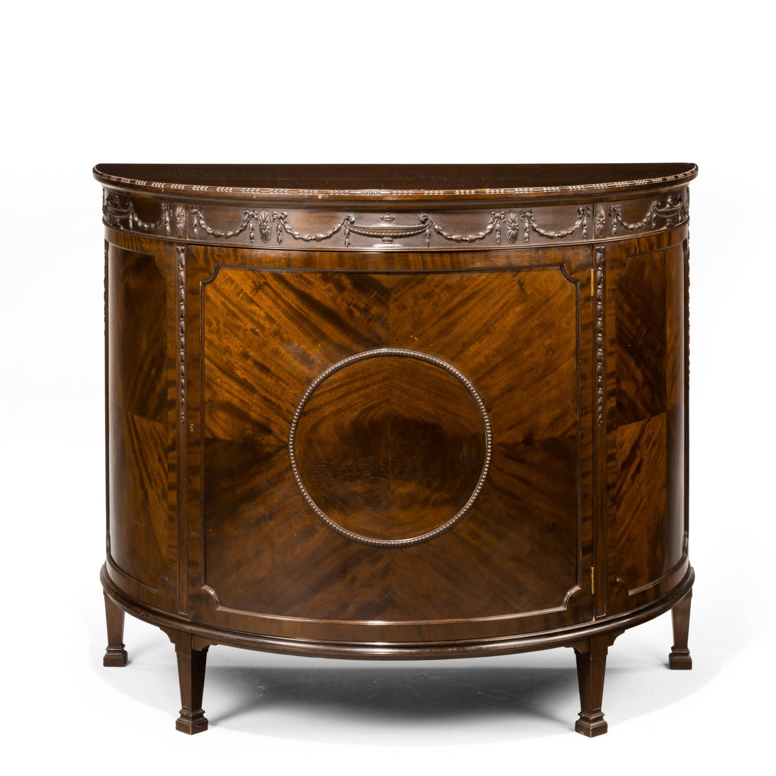 an early 20th century robert adam influenced mahogany demilune cabinet
