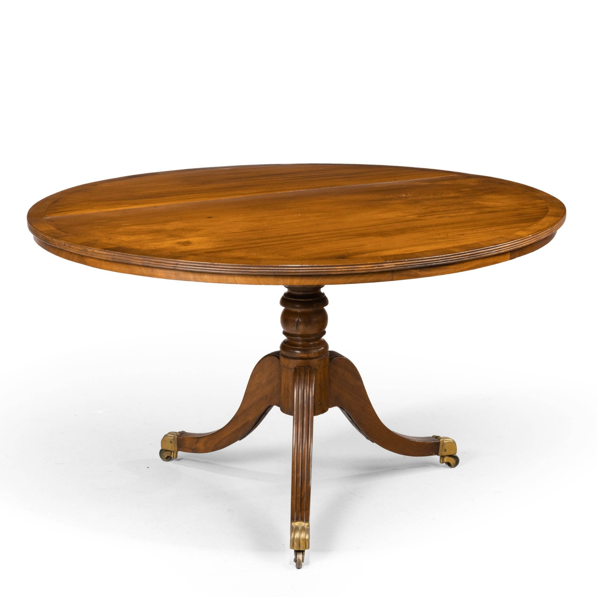 a regency period circular mahogany table