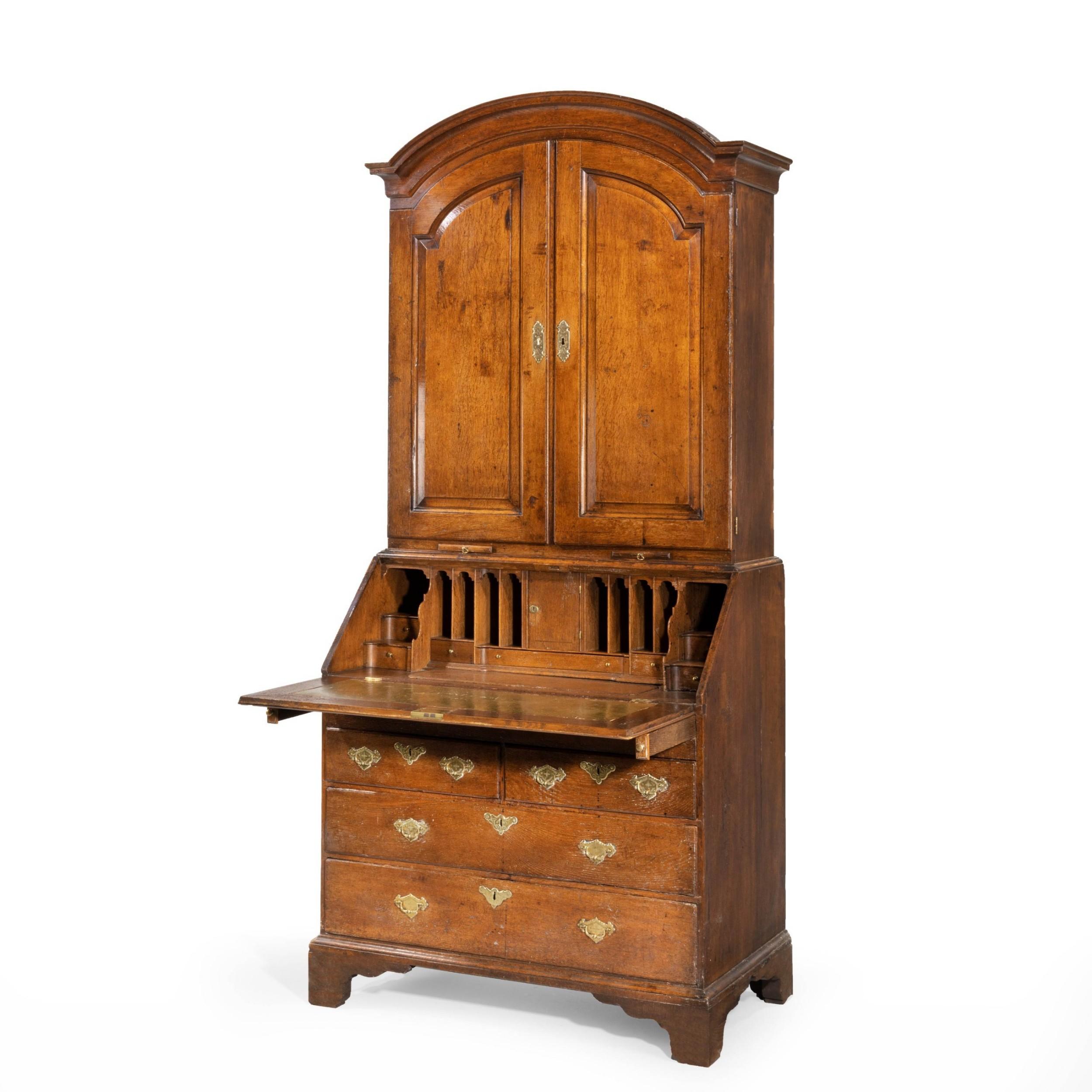 an extremely welldrawn mid 18th century oak bureau cabinet