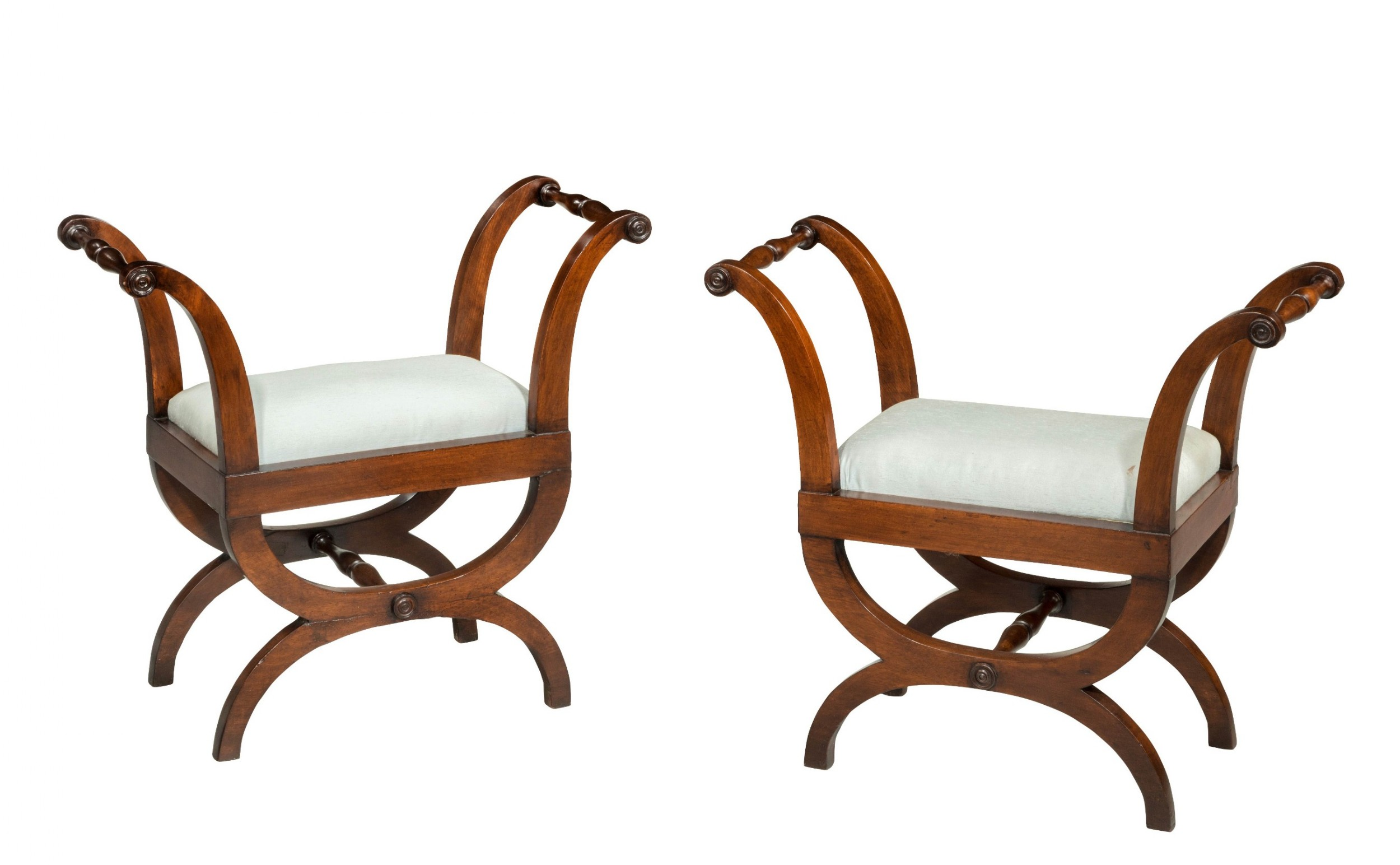 pair of early 19th century mahogany framed stools with flared uprights