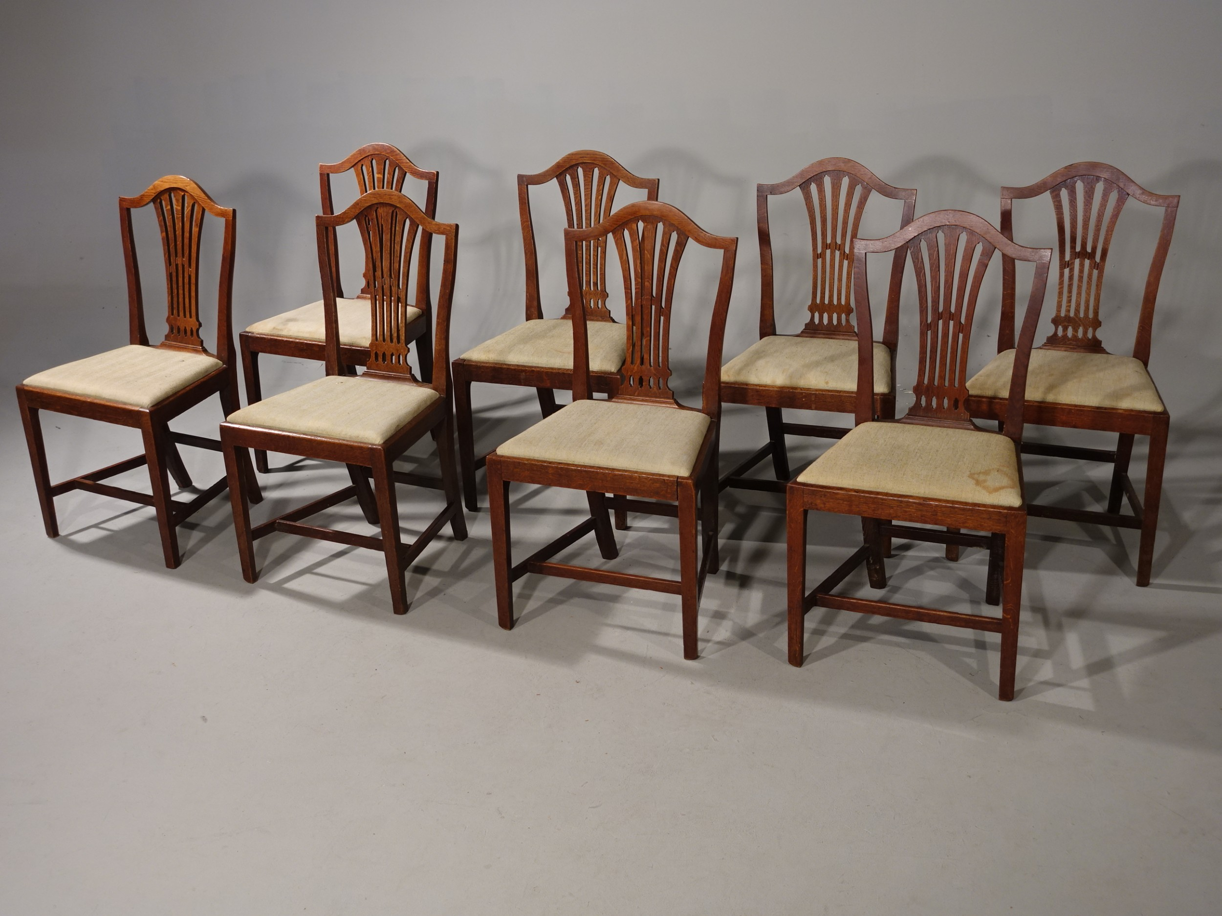 a set of eight early 19th century camel backed hepplewhite style mahogany framed dining chairs