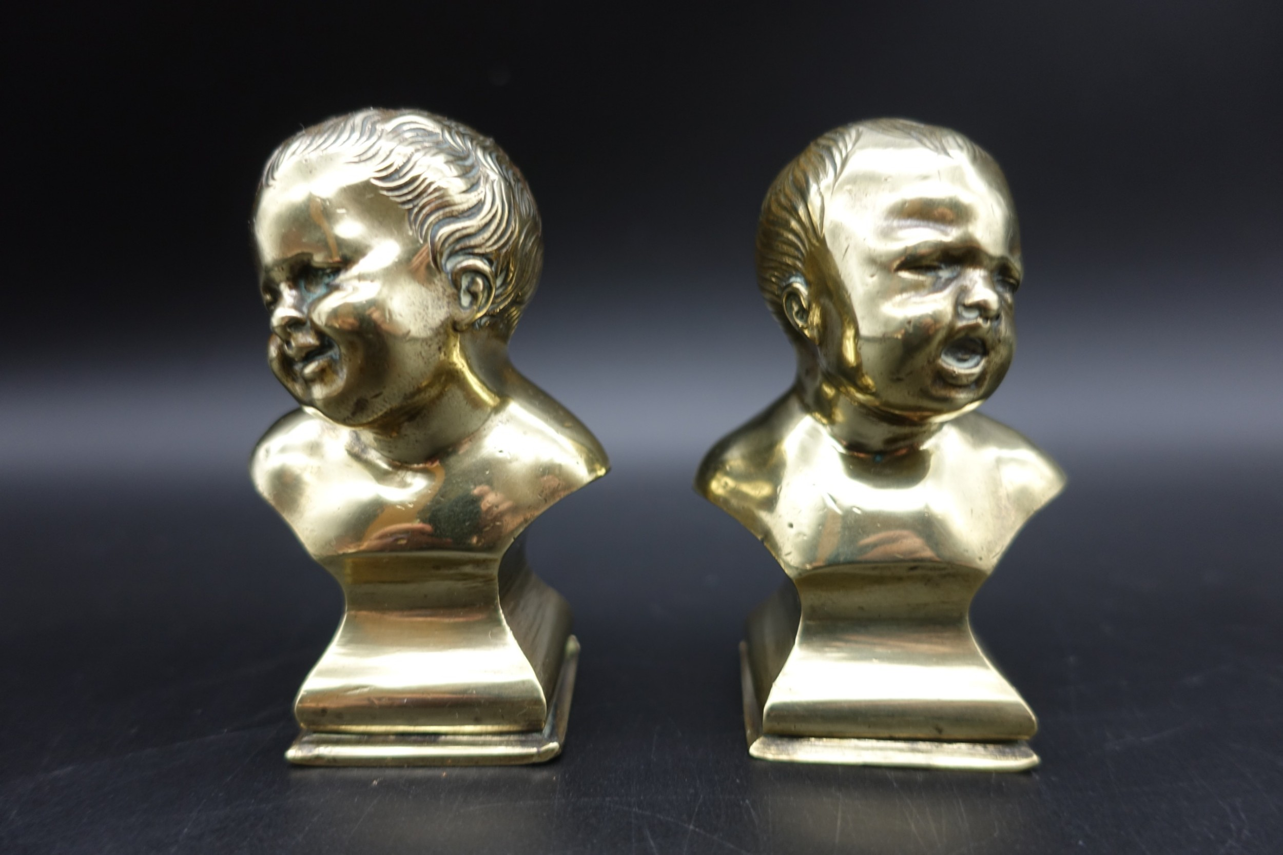 a pair of late 19th century miniature french brass paperweights