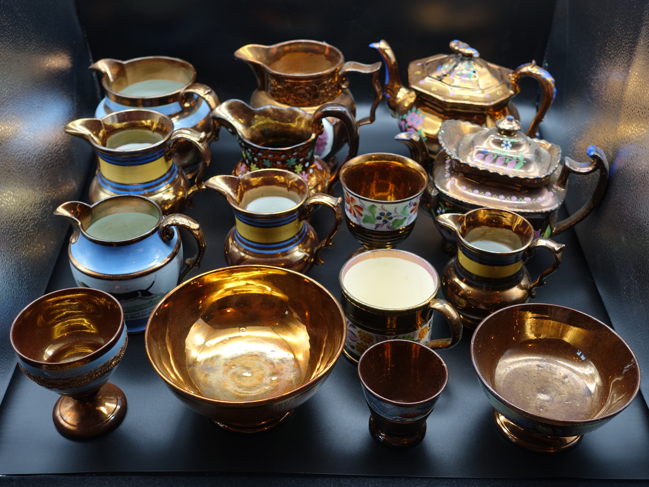 an attractive private collection of 15 pieces of 19th century copper lustre