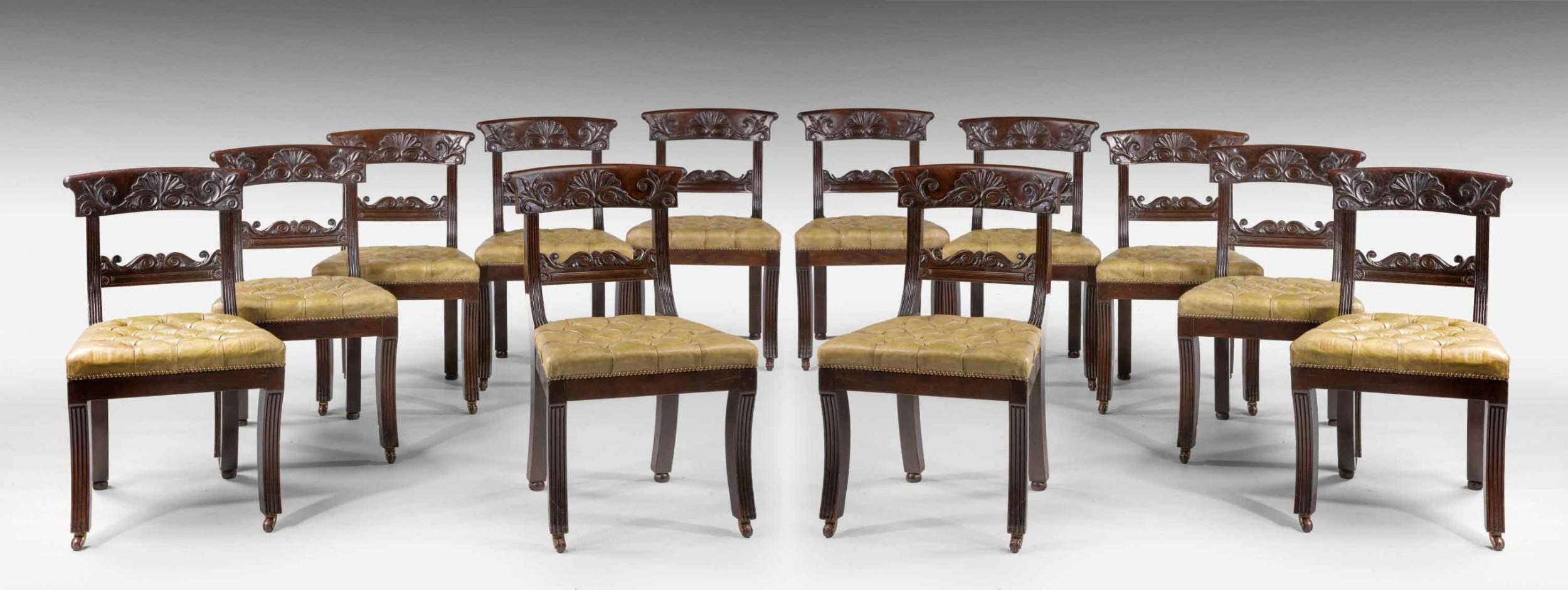 set of twelve regency period mahogany dininglibrary chairs