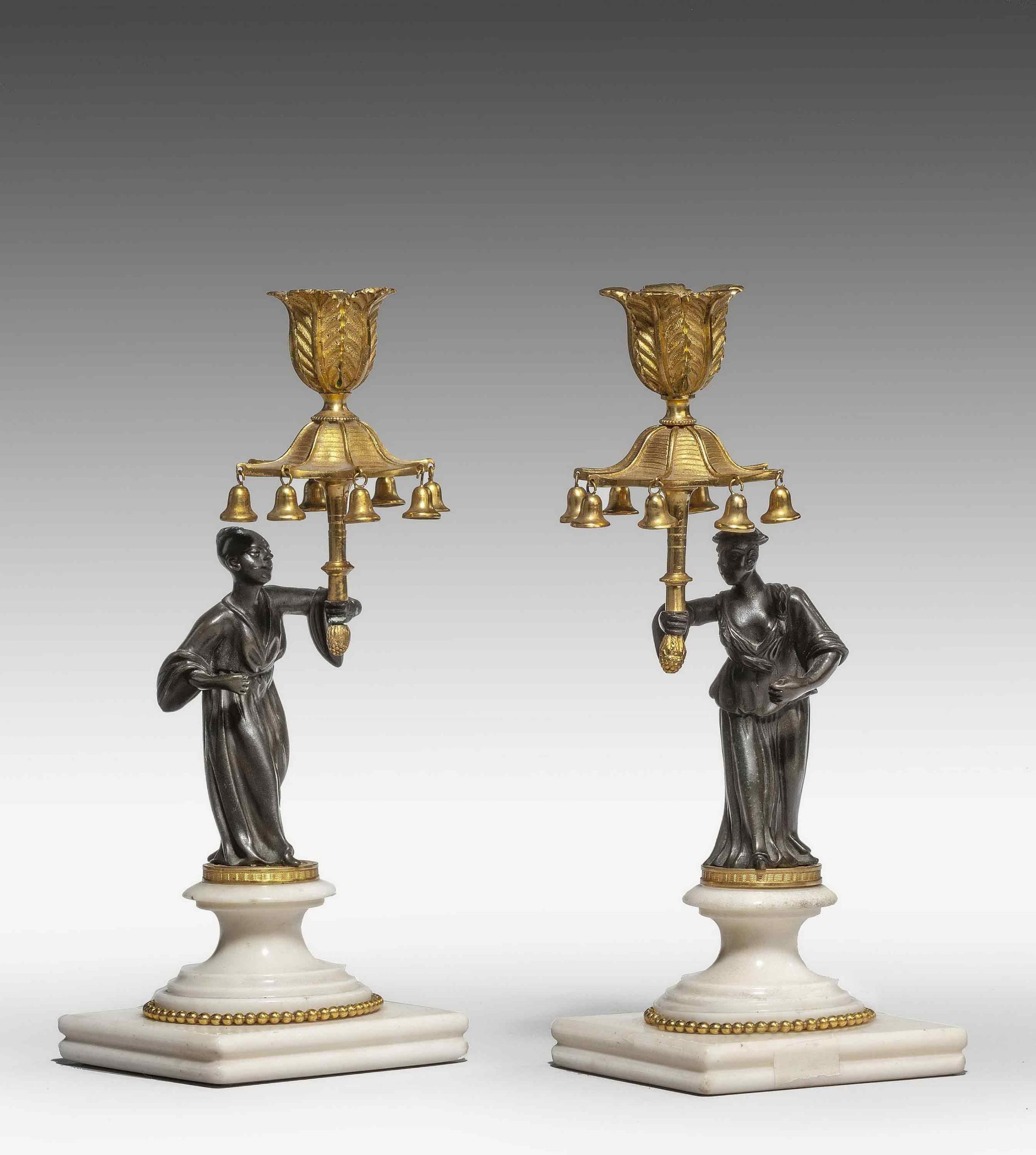 pair of regency period gilt bronze candlesticks