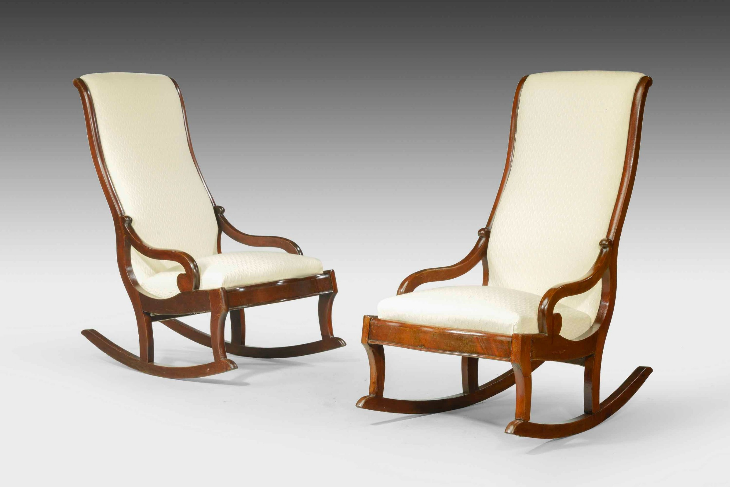 a pair of mid19th century mahogany framed rocking chairs