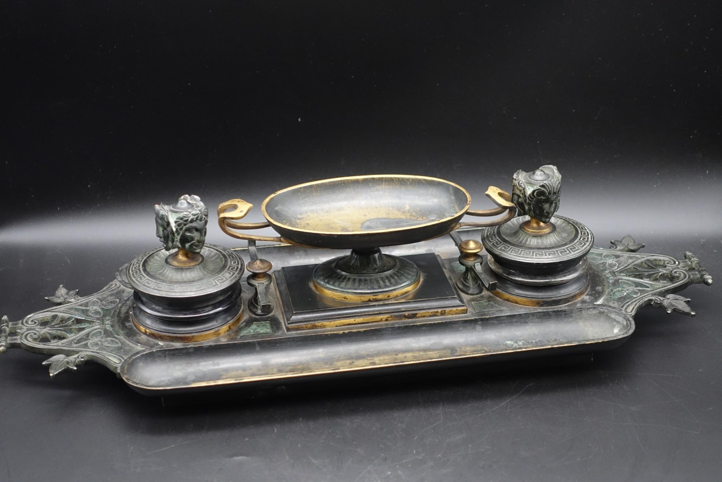 a large late 19th century cast bronze desk set
