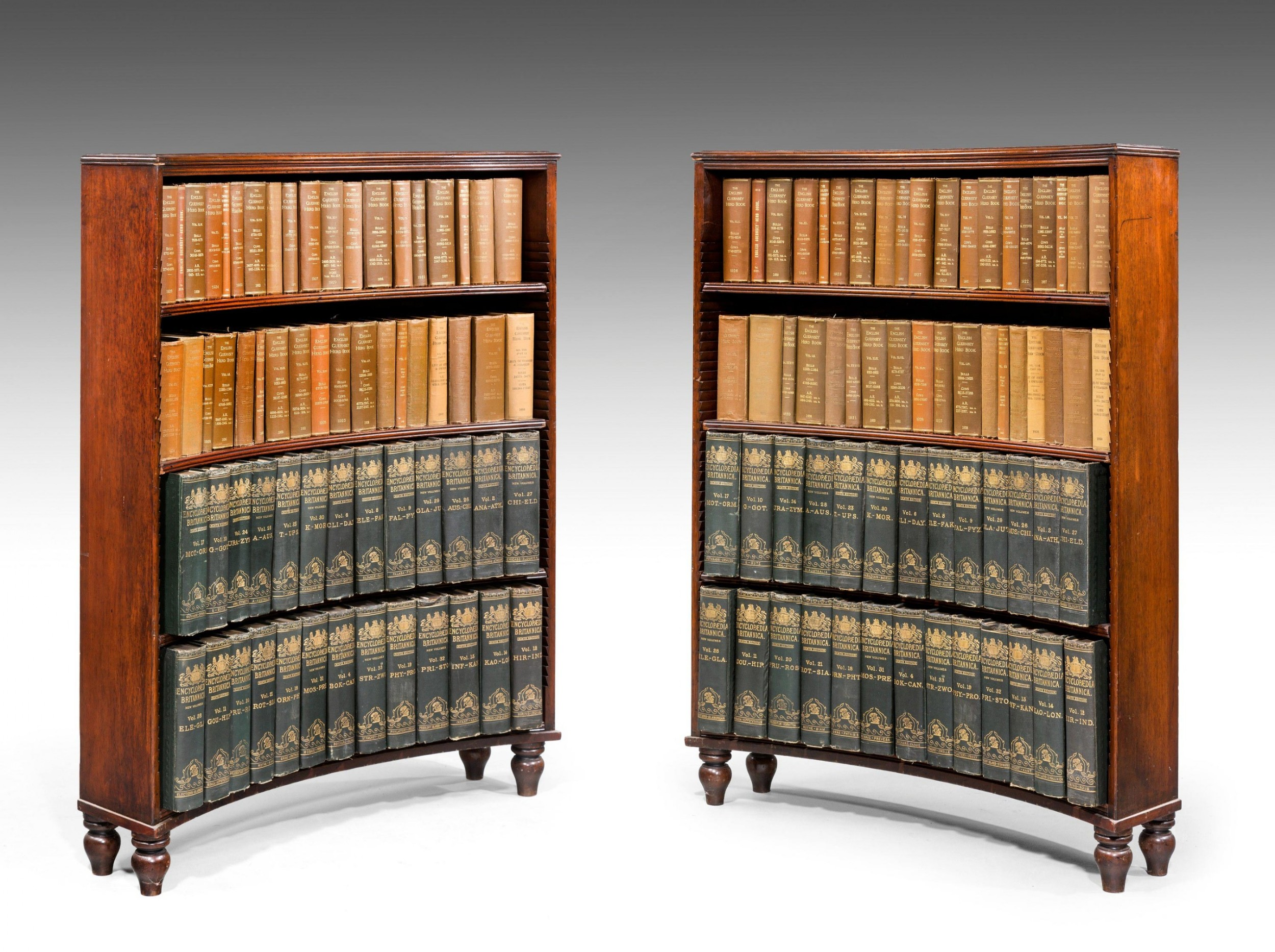 pair of george iii period mahogany concave open bookcases