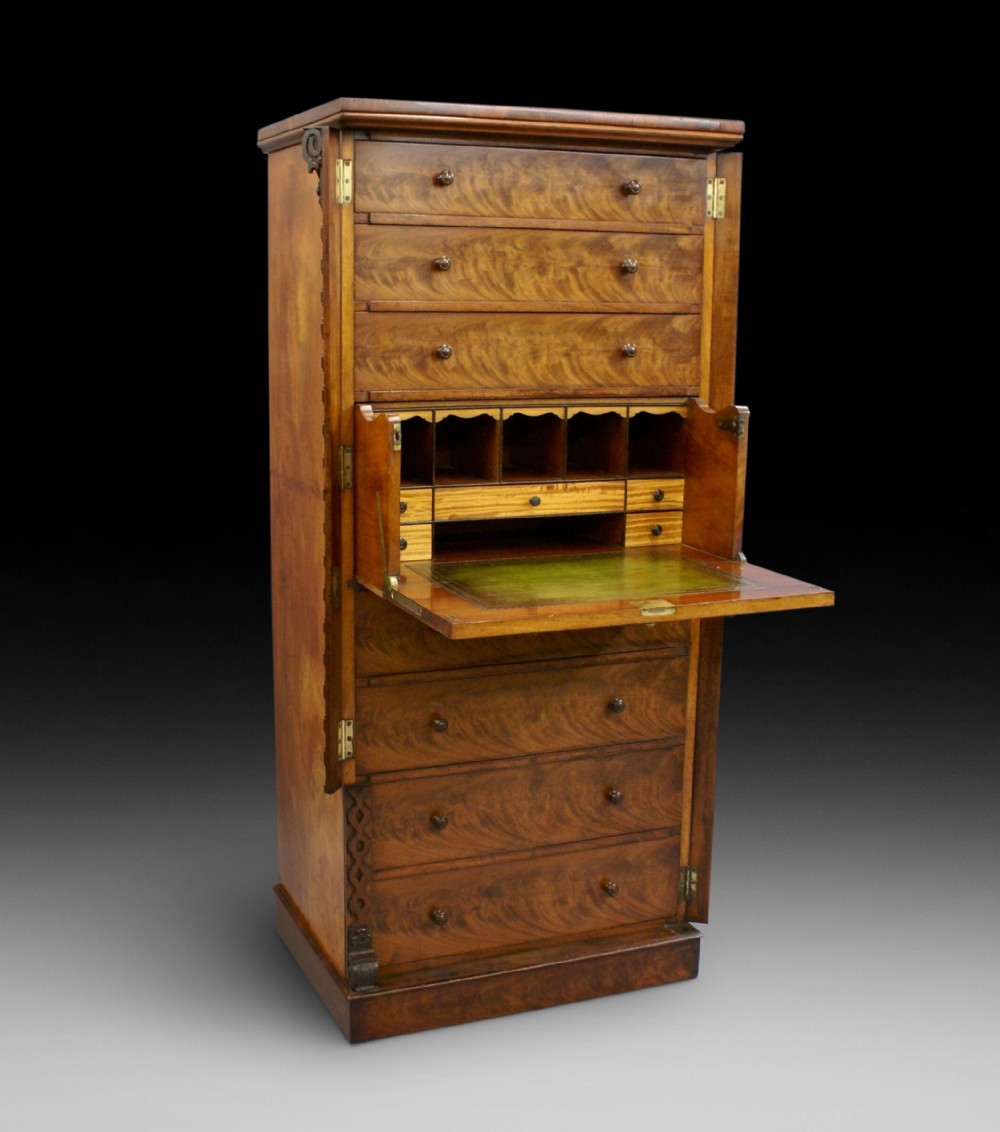 a flame mahogany secretaire wellington chest