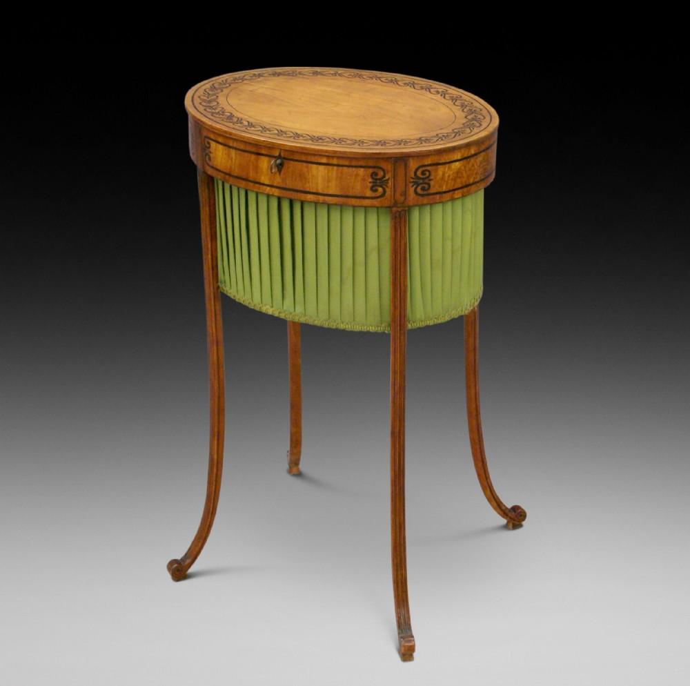 a fine regency satinwood work table