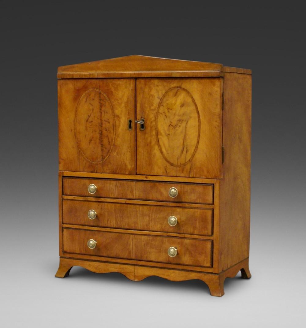 a rare regency miniature satinwood linen press