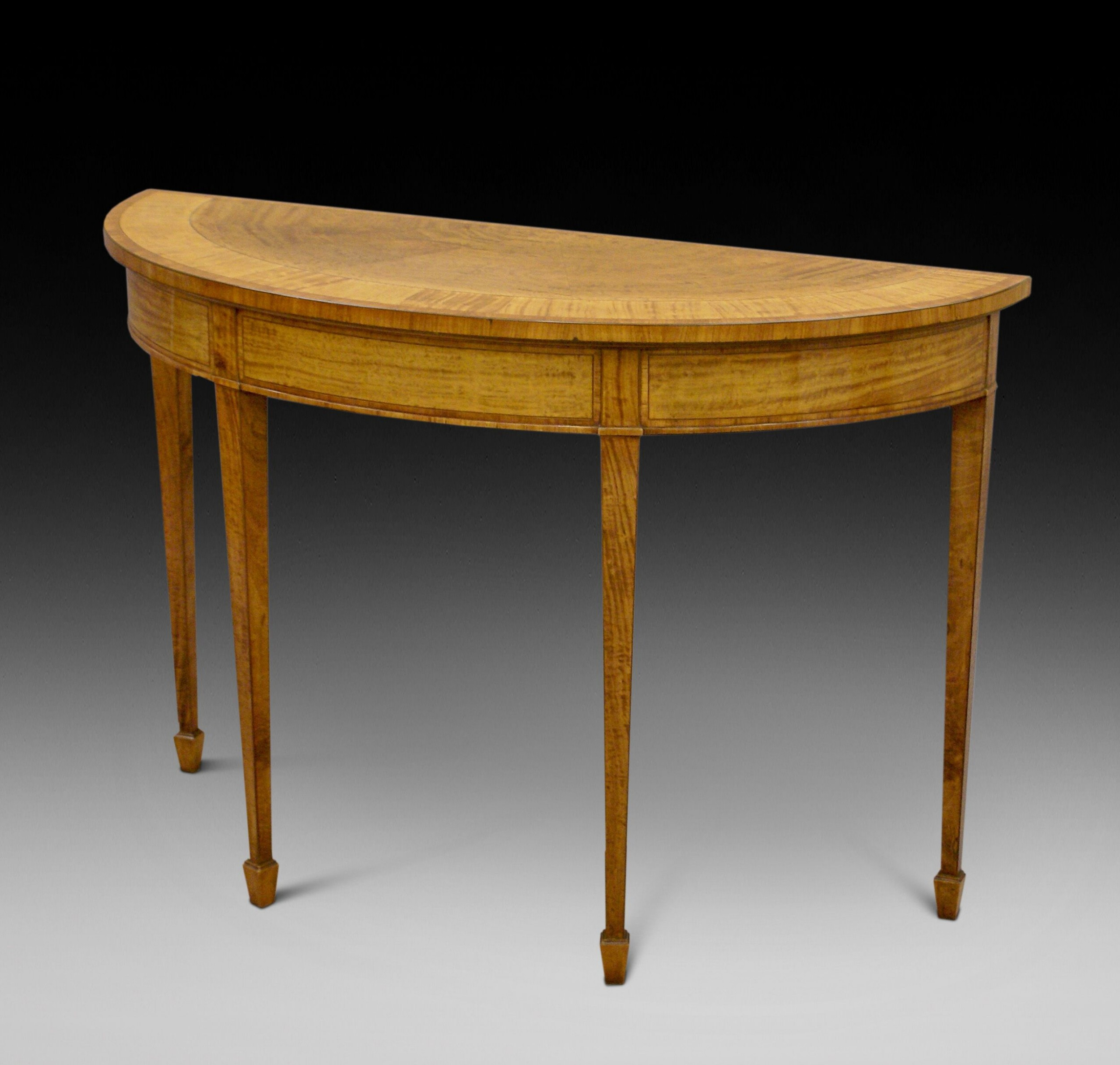 a satinwood demi lune console table