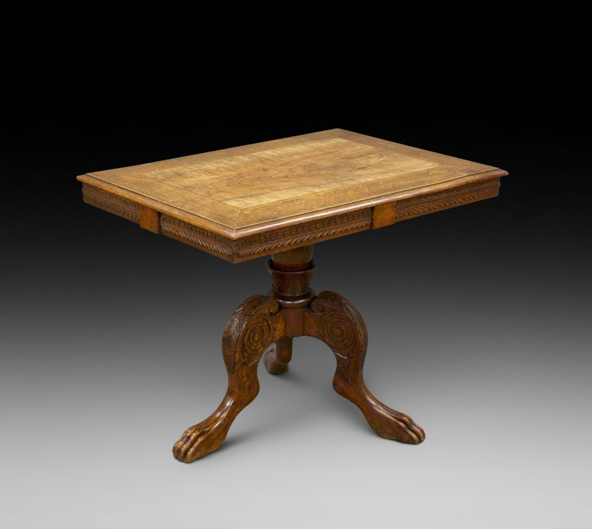 an unusual colonial tripod center table