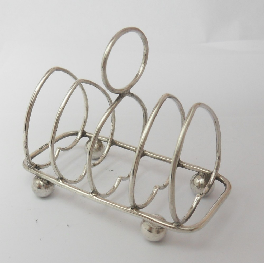 edwardian 'heart' silver toast rack by walker hall