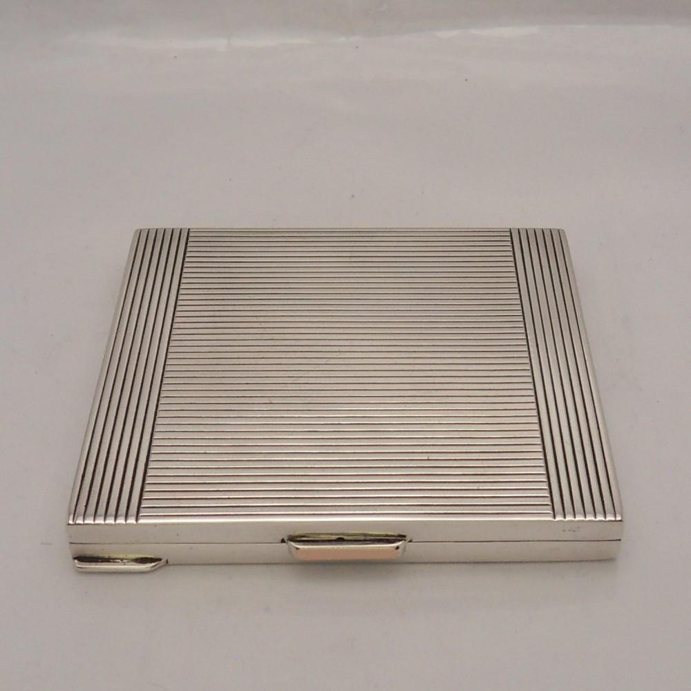 stylish square silver compact case london 1944
