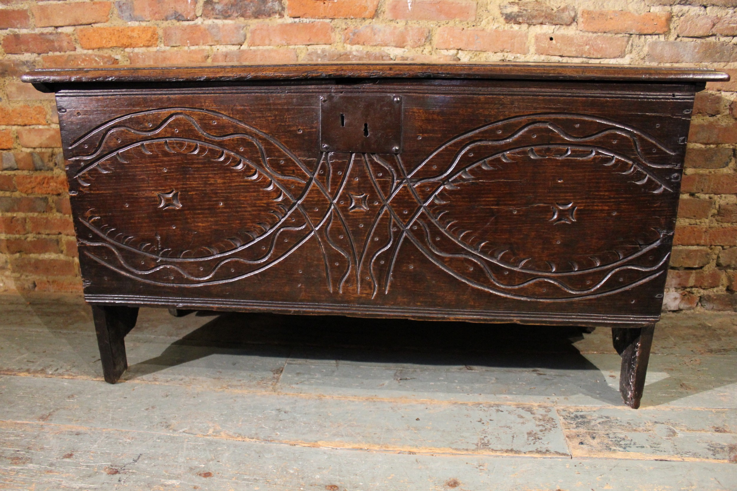 an unusual 17th century carved oak and elm coffer