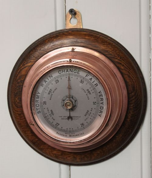 small copper aneroid barometer