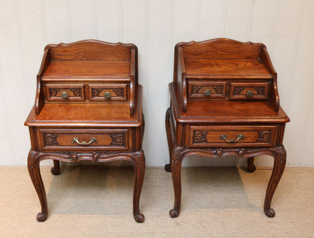 pair of french solid oak bedside cabinets