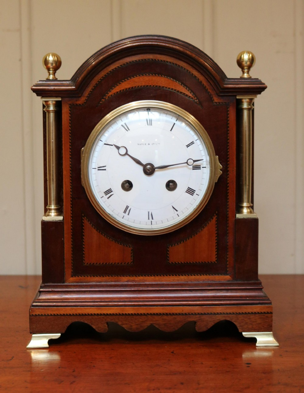 mahogany and satinwood mantel clock by maple co