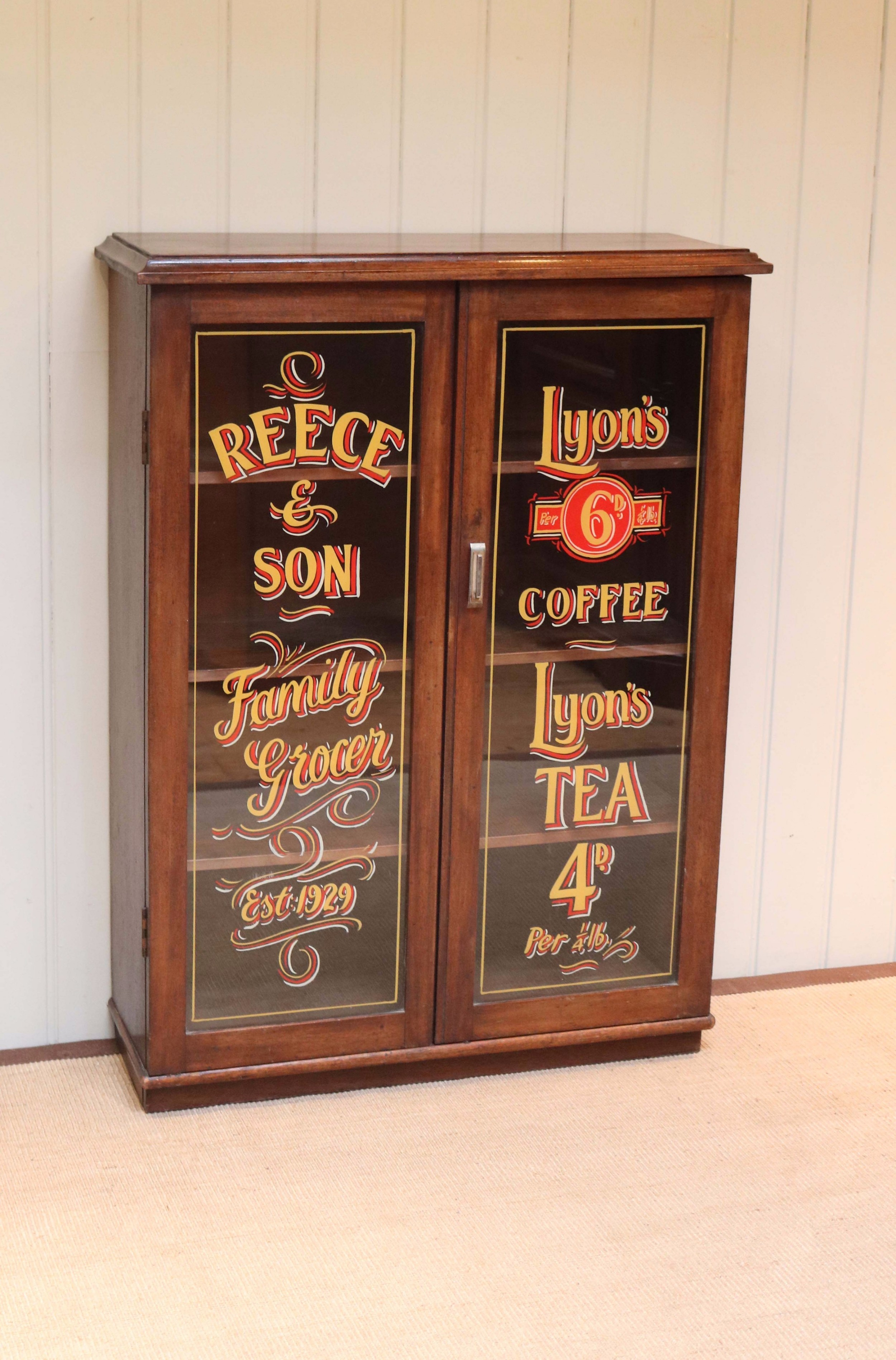 mahogany two door shop display bookcase