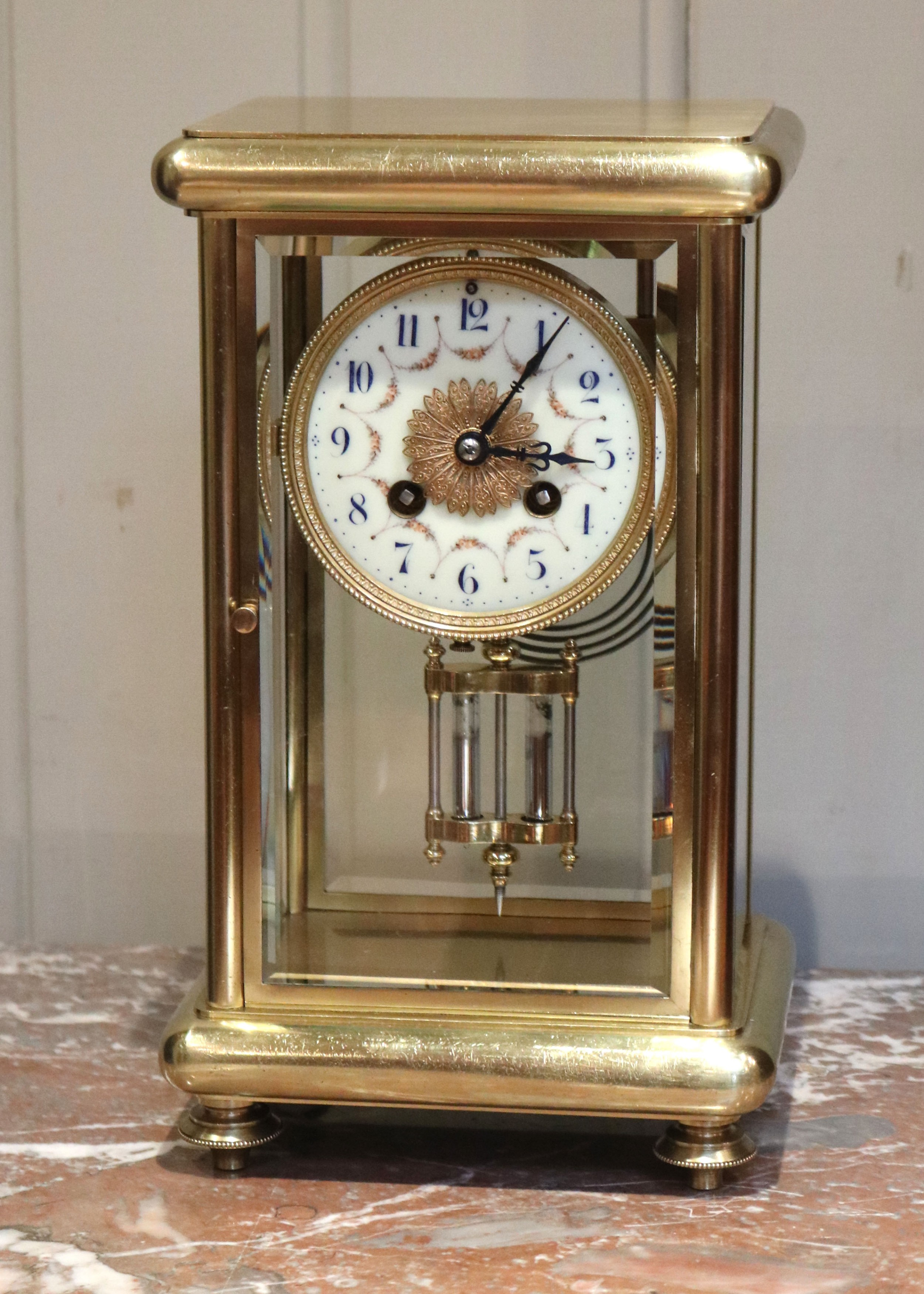 french brass four glass clock with ornate dial france c 1905