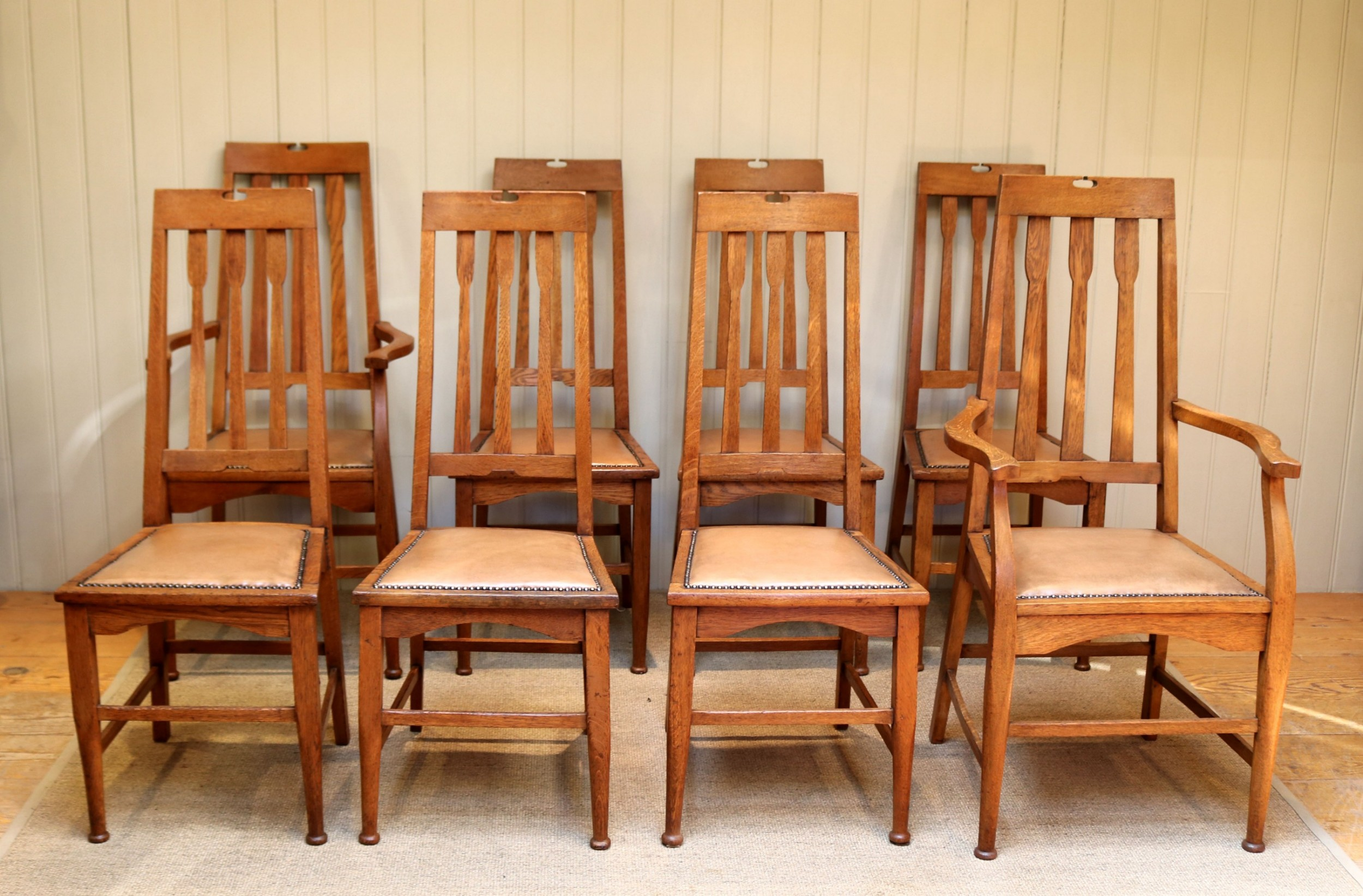 set of eight arts and crafts dining chairs