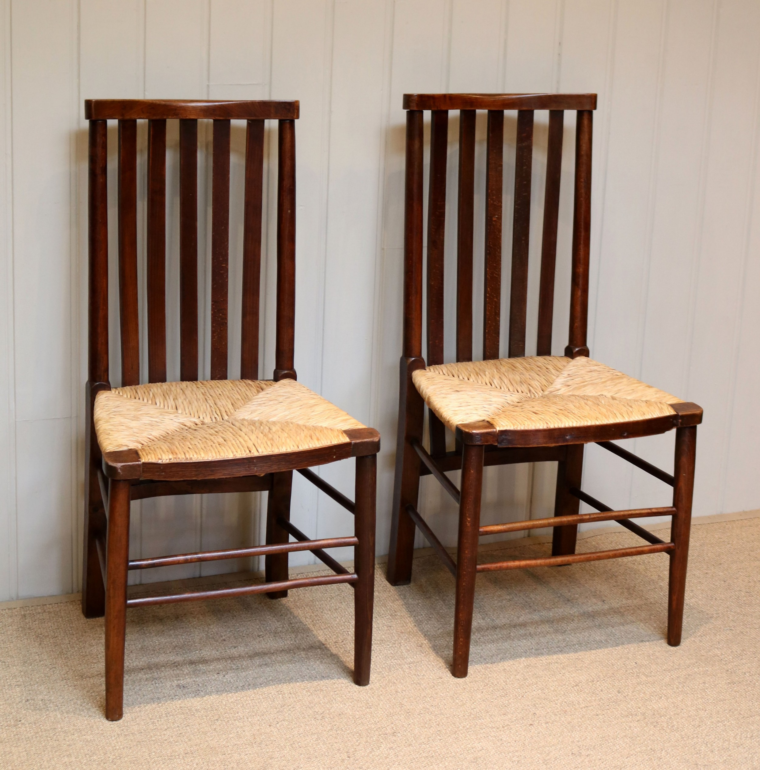 pair of arts and crafts beech framed chairs