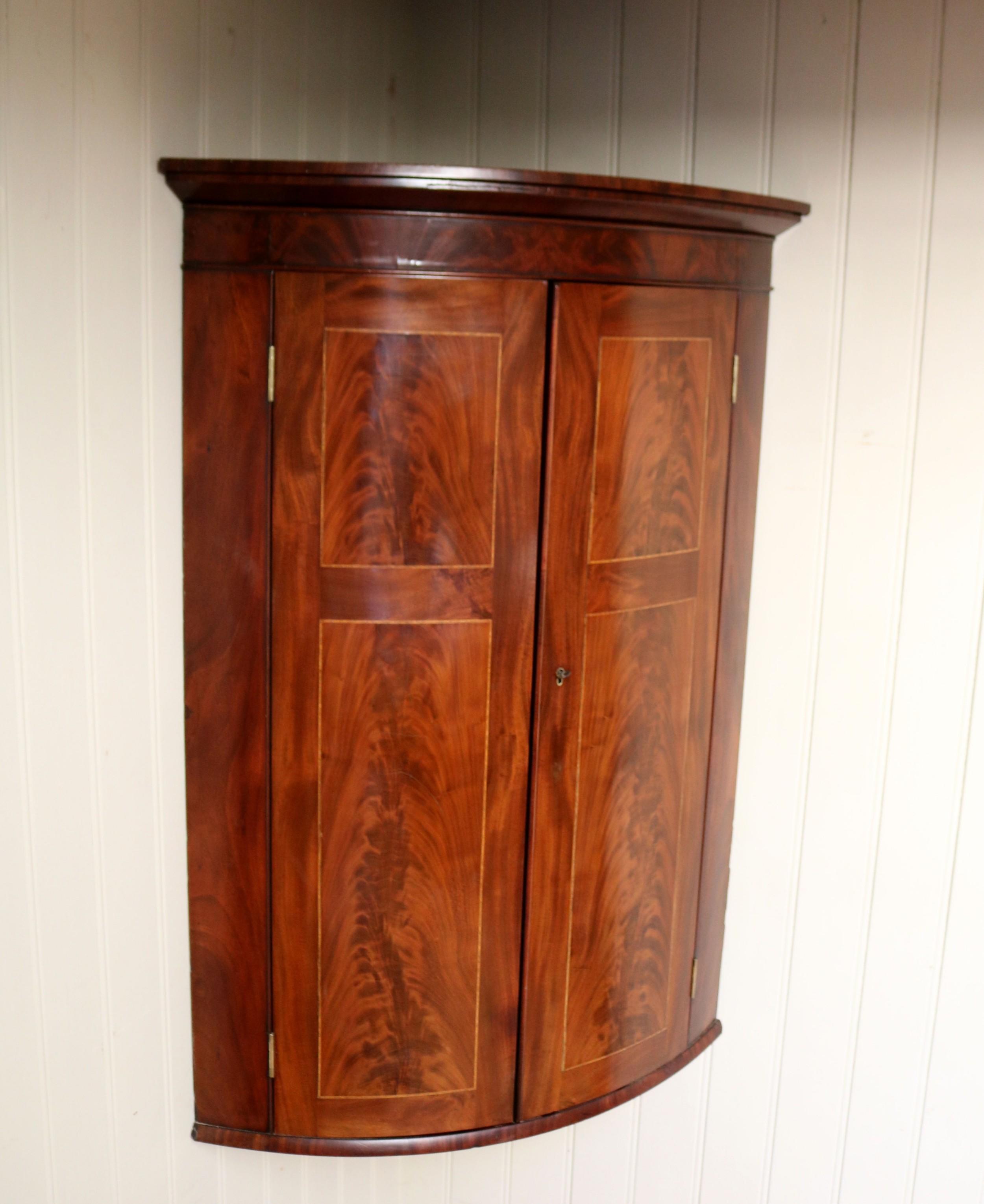 early 19th century mahogany bow front corner wall cabinet