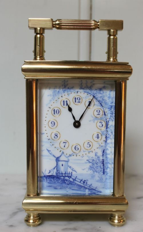 unusual enamel panel carriage clock