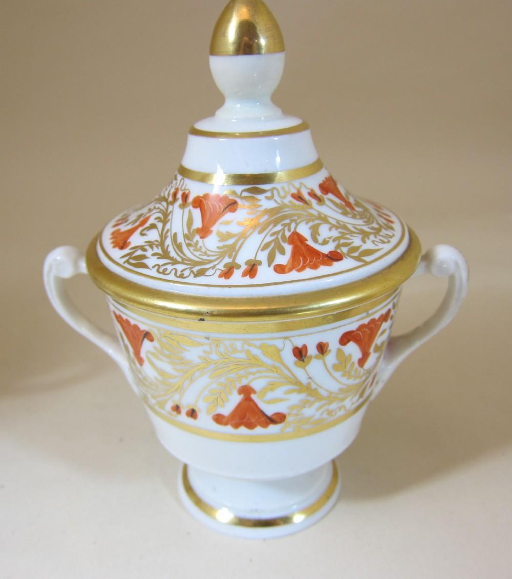english porcelain 2 handled cup lid with orange gilt decoration