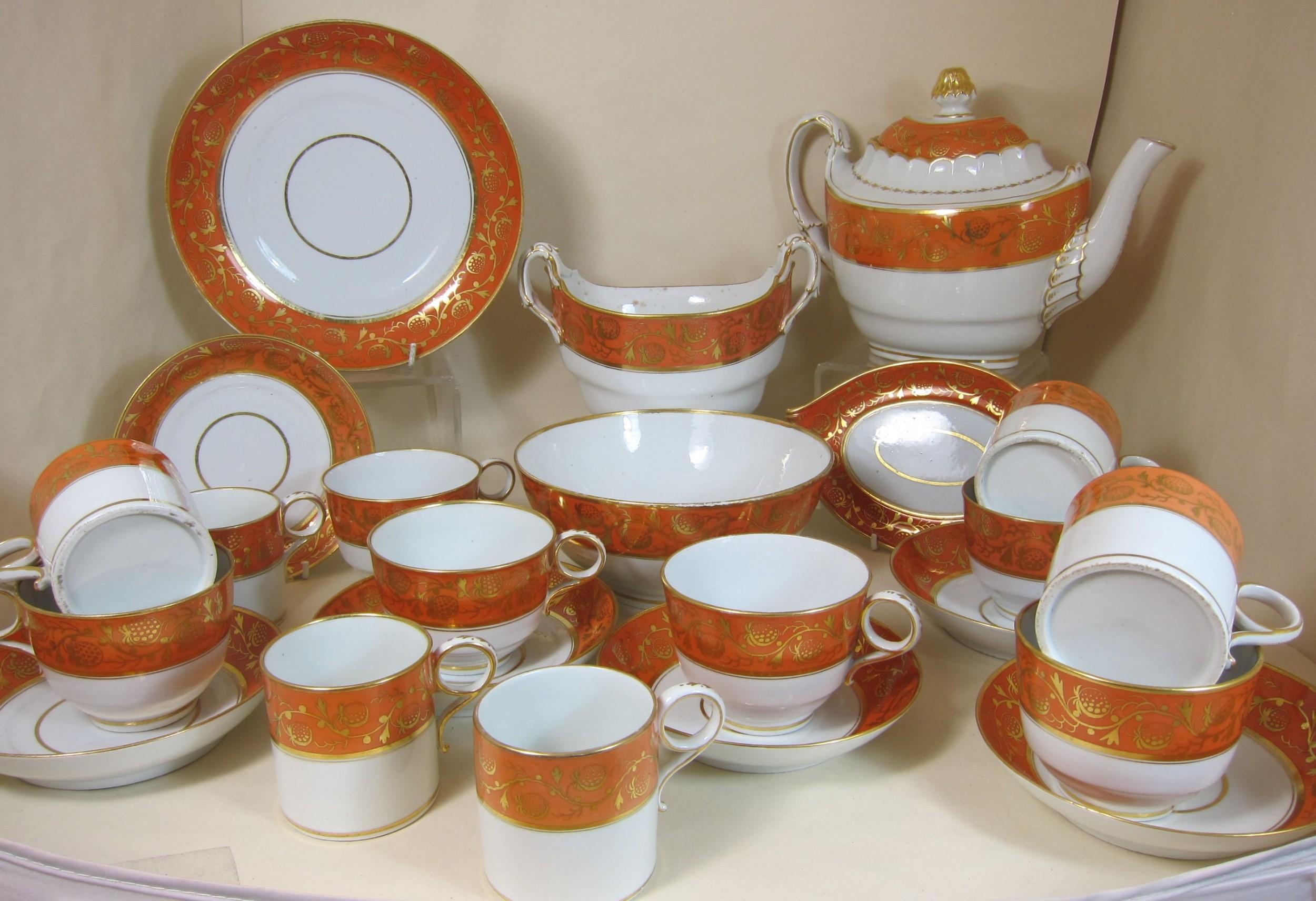 worcester porcelain part tea service with orange band strawberry gilding