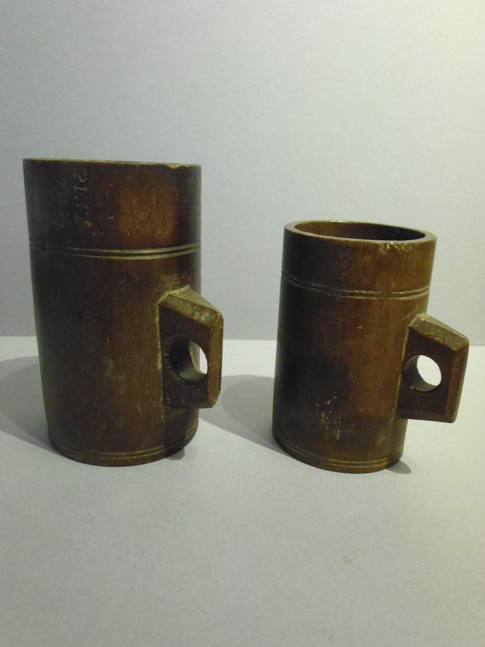 two 19th century treen oak measures