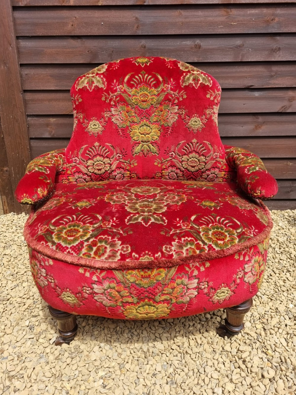 a late victorian tub proportioned club elbow chair curved back serpentine arms stuffed over