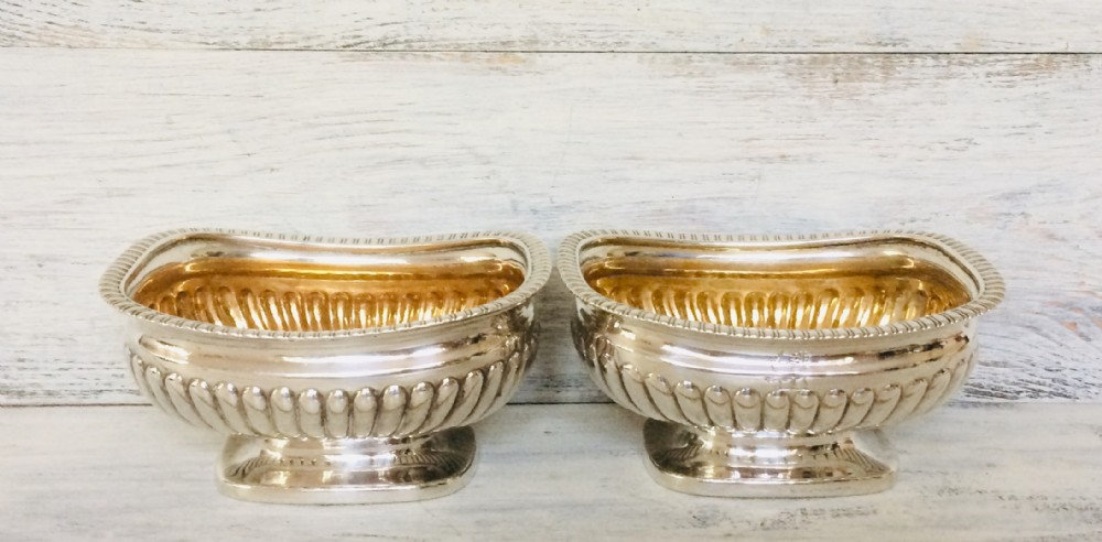pair of georgian silver salts with gilded interiors