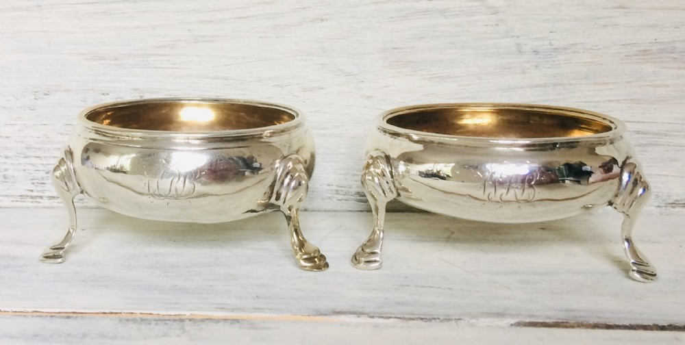 a pair of georgian silver salts with gilded bowls