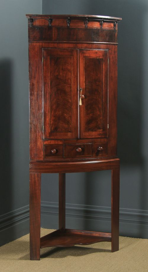 antique english georgian flame mahogany floor standing bow front corner cupboard on stand circa 1820