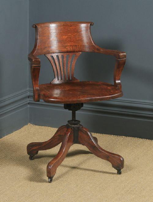 antique english edwardian solid oak revolving office desk arm chair circa 1910
