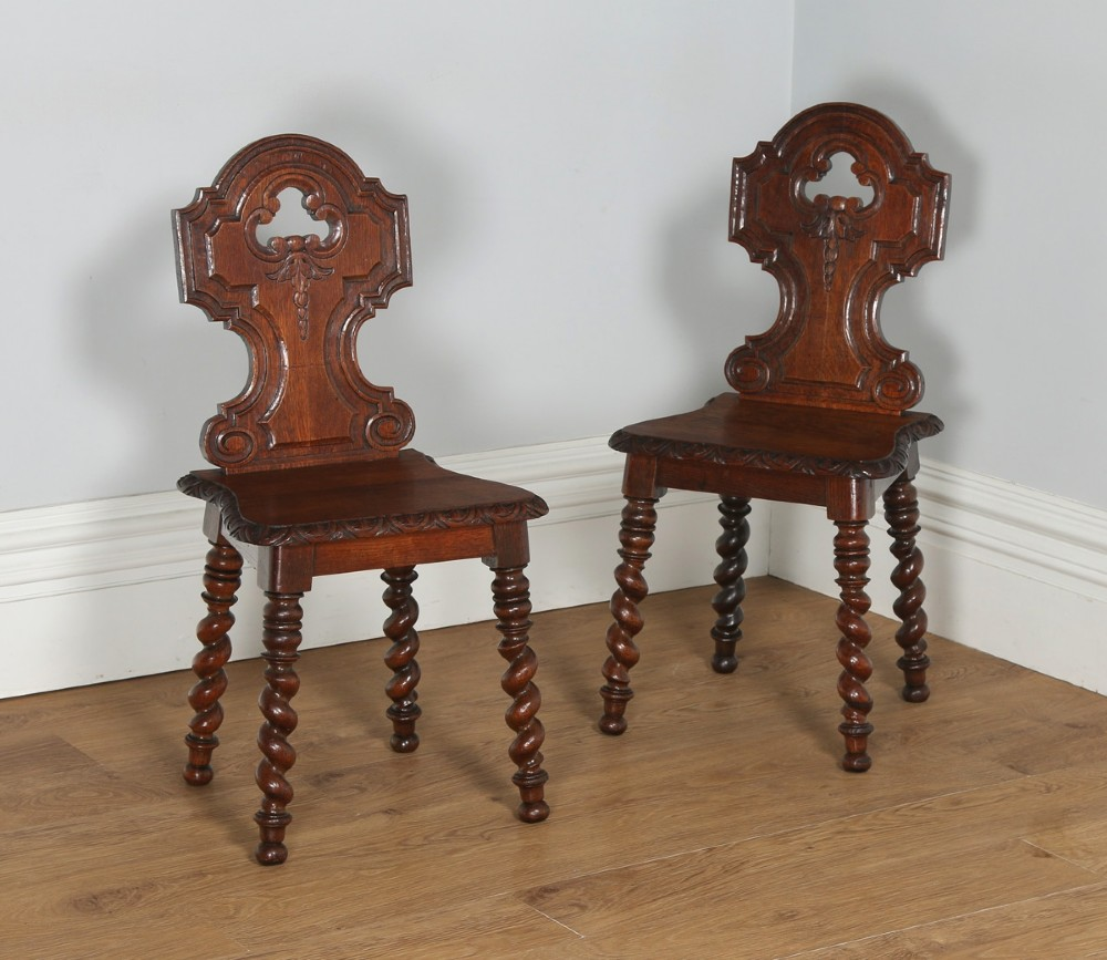 antique english victorian pair of gothic style carved oak hall side chairs circa 1860