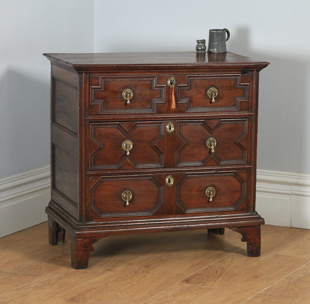 small antique english william mary 17th century oak panelled geometric chest of drawers circa 1690